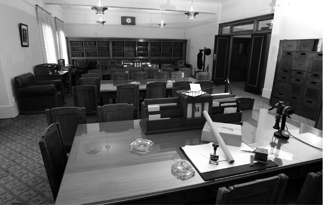 Black and white image of the inside of the Government Party Room at Old Parliament House.