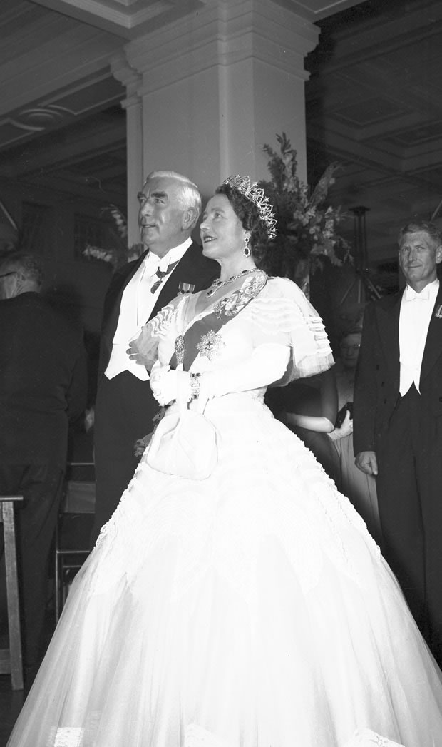 Black and white image of Her Majesty Queen Elizabeth, the Queen Mother, with Prime Minister Robert Menzies at the state ball in Kings Hall in 1958.
