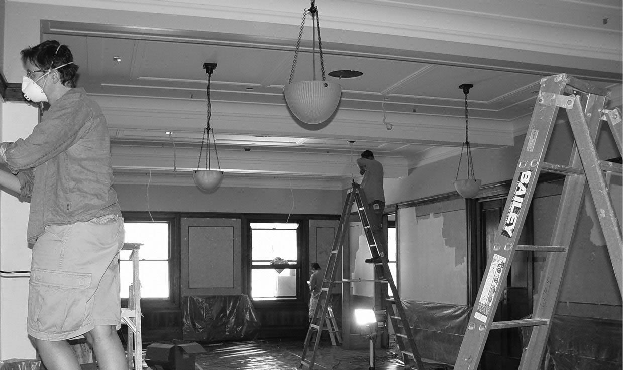 A photo of conservators at work in the Members' Private Dining Room.
