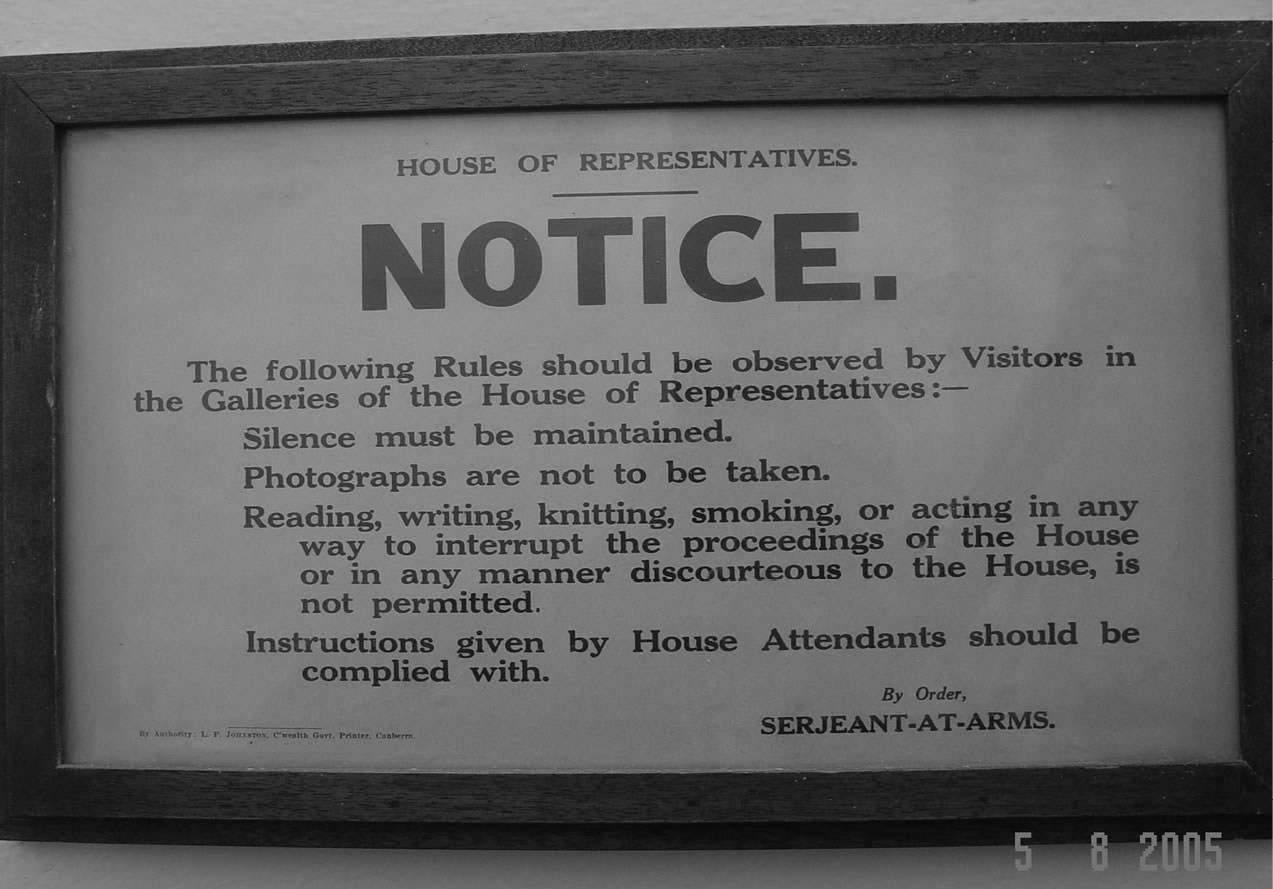 A black and white photo of a heritage sign in the stairwell to the House of Representatives Visitors Gallery.