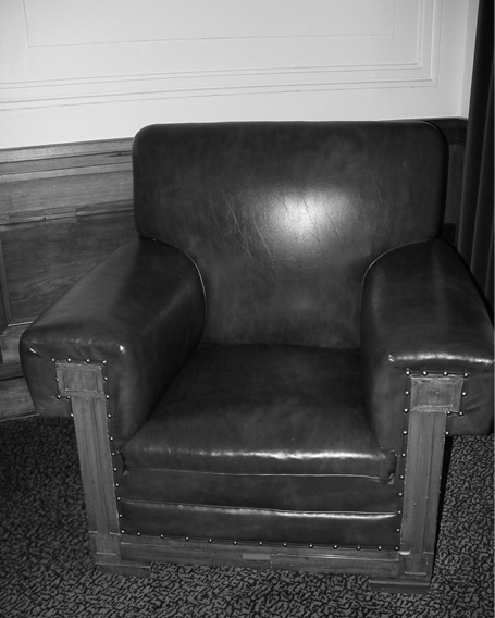A black and white photo of a John Smith Murdoch FB37 easy chair.