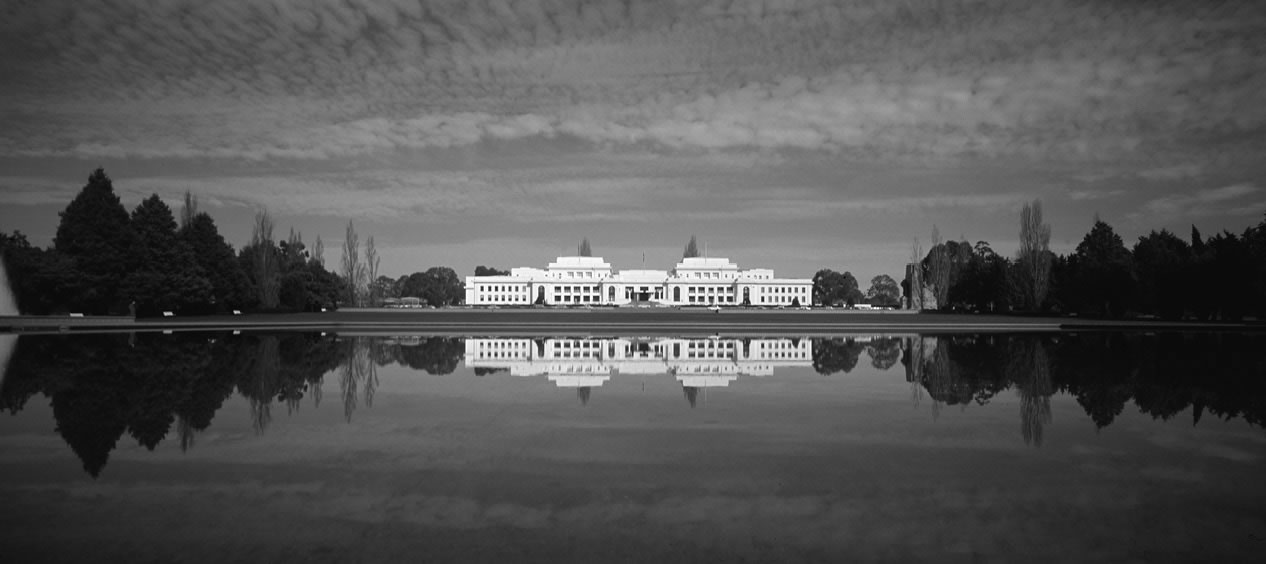 Black and white image of the front of Old Parliament House.